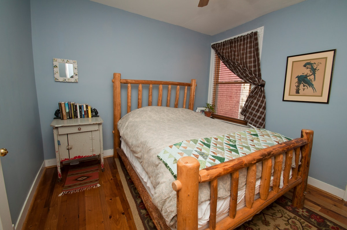 This the guest bedroom you rent with handmade log bed and super comfortable high-end mattress.