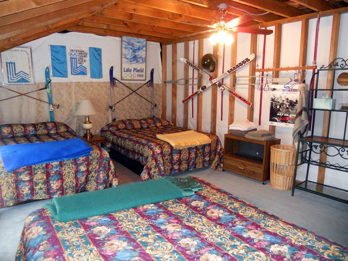 Dorm bedroom has 3 double beds.
