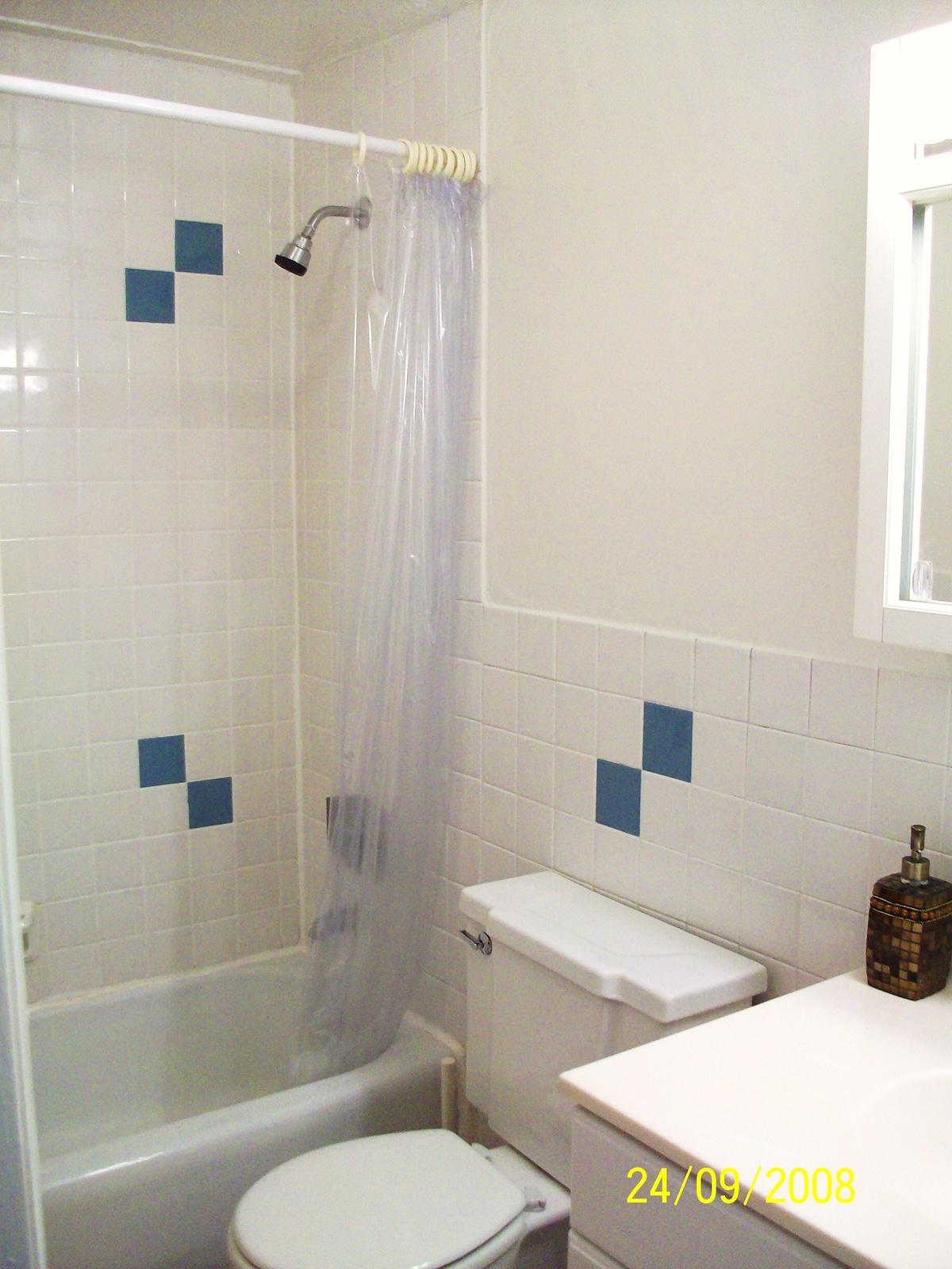 Modern Tiled Bathroom w/ Full Bathtub & Shower.