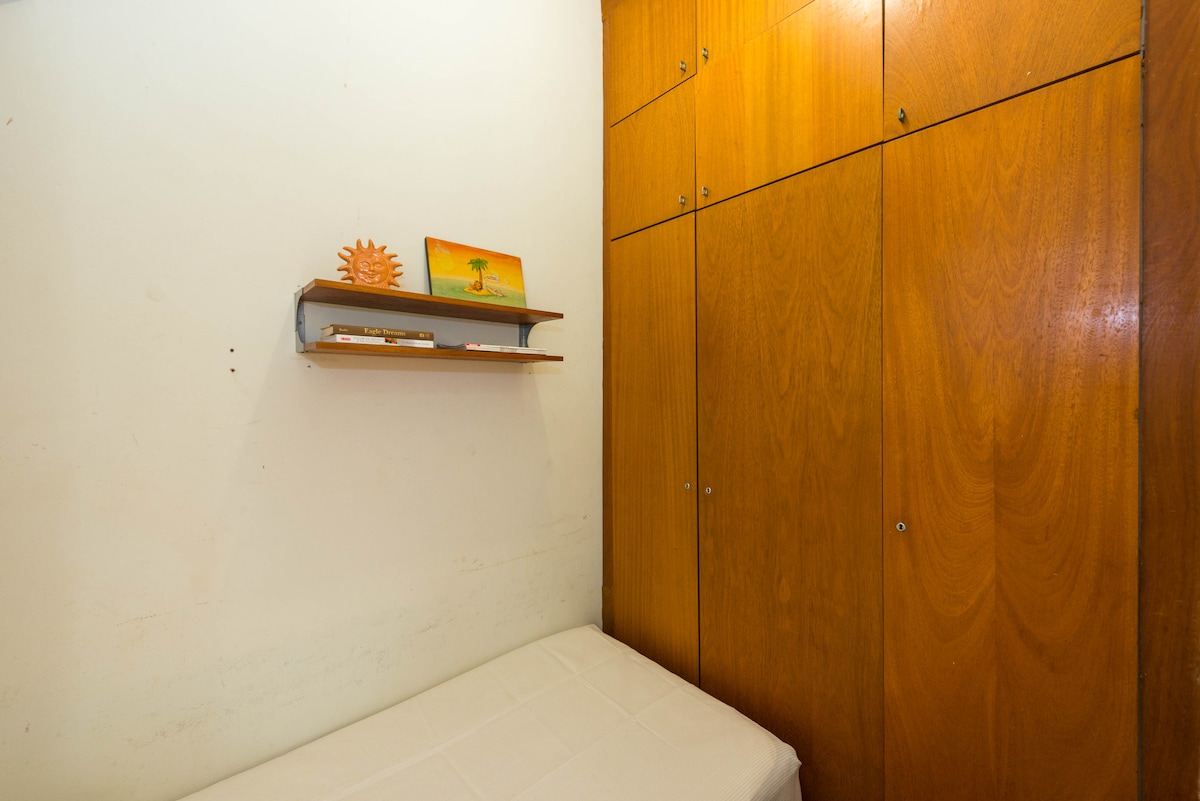 second small room with single bed.