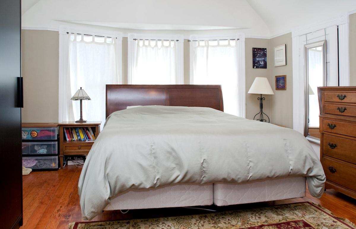 Master bedroom with California king size bed