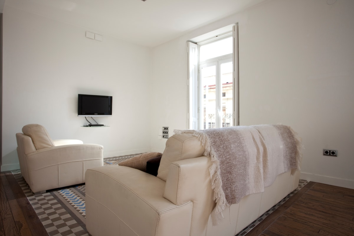 TV and sitting area of the lounge