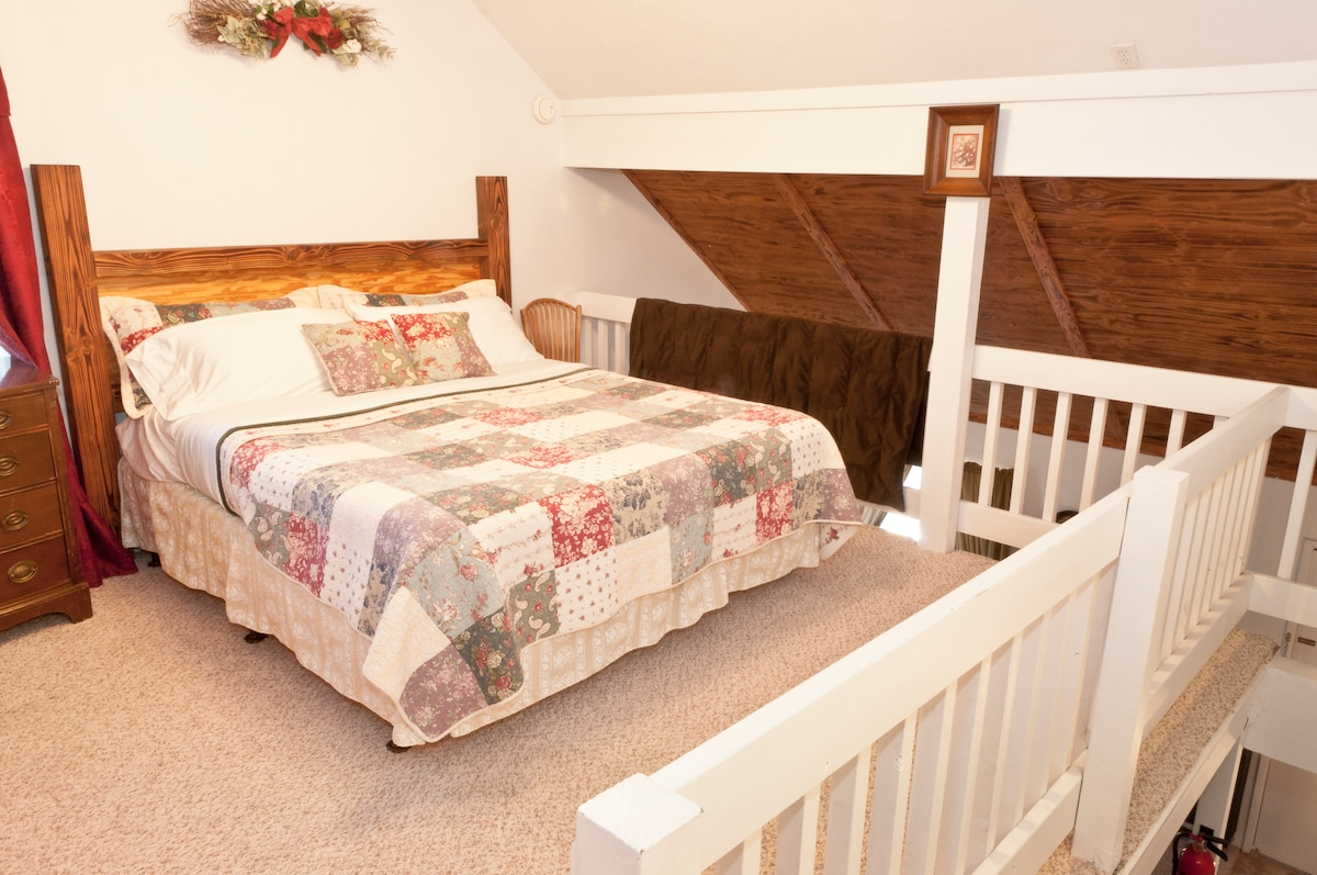 King bed in upstairs loft.