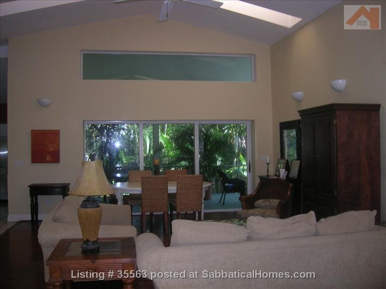 Open living area of our home, lanai in background