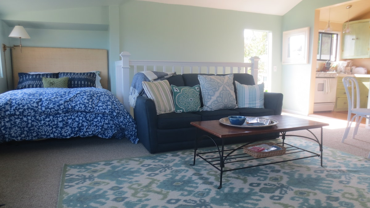 Full size bed with ocean views - upstairs in main living area