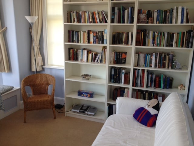 The sitting-room with the books. Help yourself, but leave them behind.