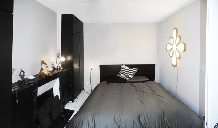 bedroom with large real bed and nice vintage and new designers furniture