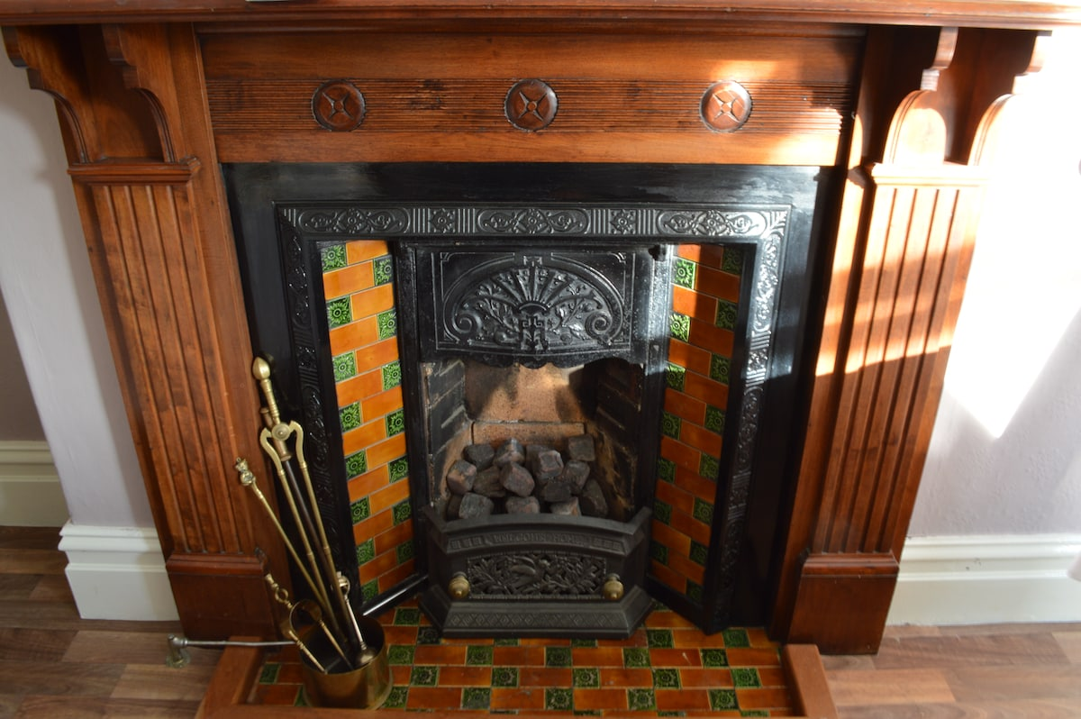 Beautiful Victorian fire place in the dining room.