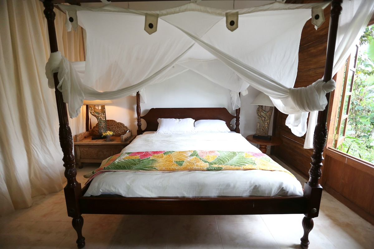 Bedroom two with handpainted Balinese quilt