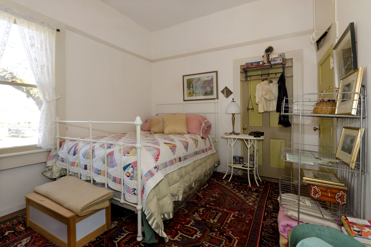 Small ground floor bedroom furnished in antiques