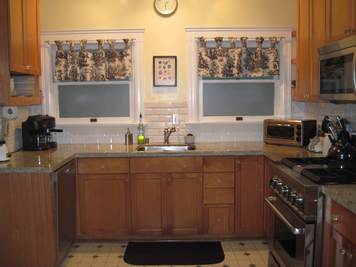 Granite counters and stainless steel appliances.