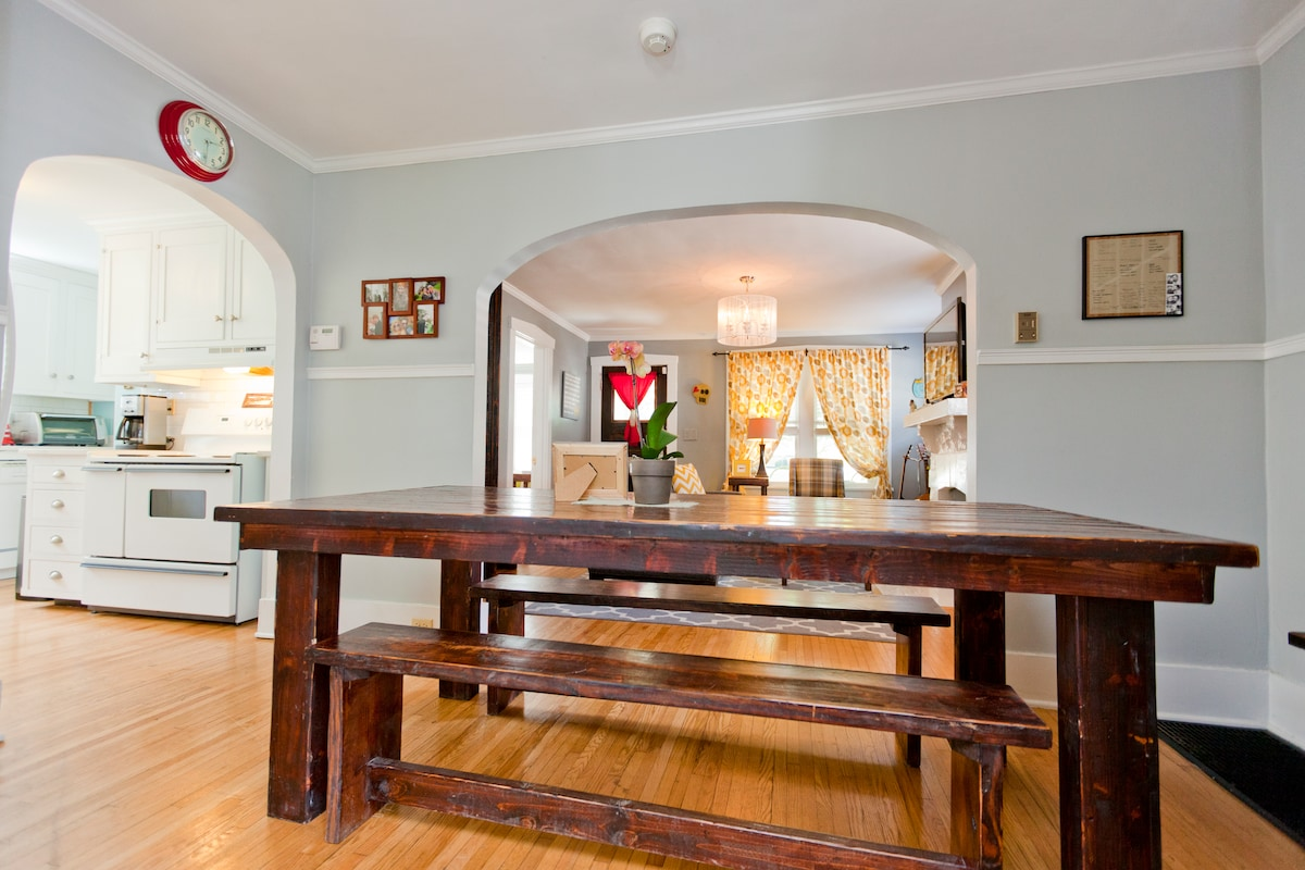 Handmade farmhouse table with bench seating for 10.