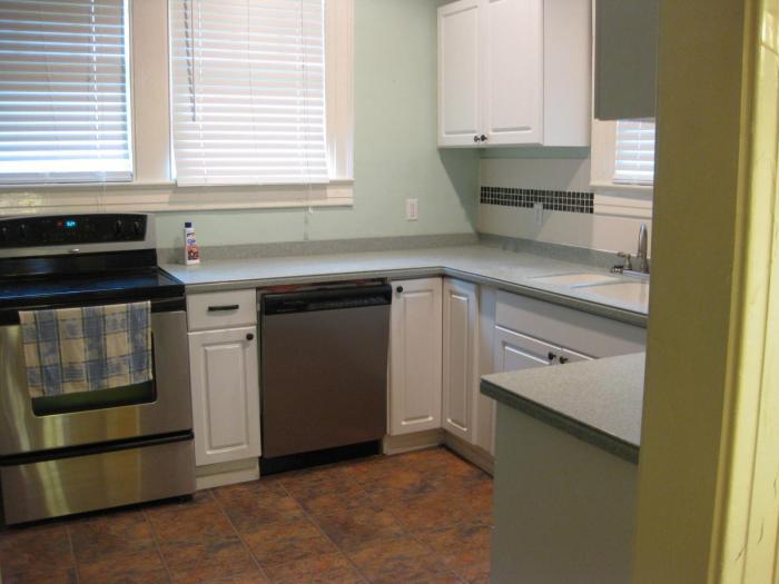 New kitchen, stainless appliances, corian tops, overlooks back garden