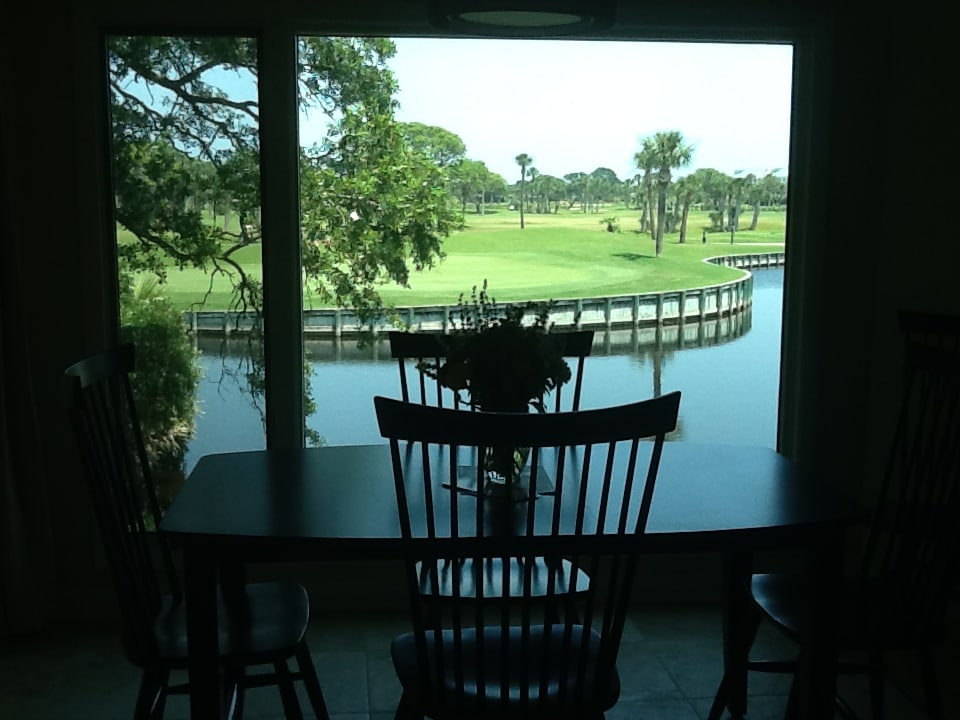 View of pond and 18th green on Crooked Oaks from dining room