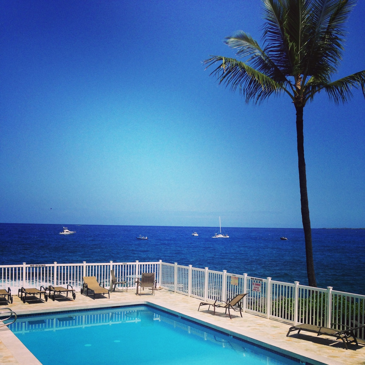Enjoy sweeping ocean views from your pool chair