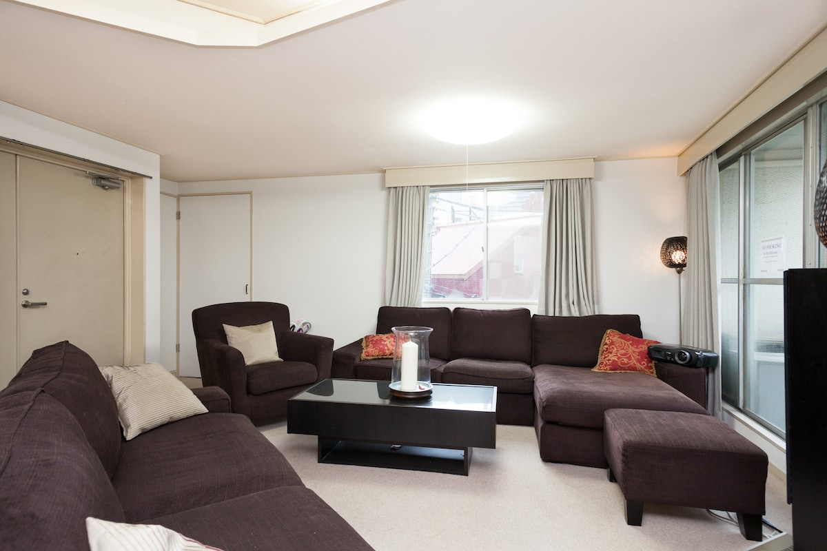 Nice big living room with soft and comfortable sofas!