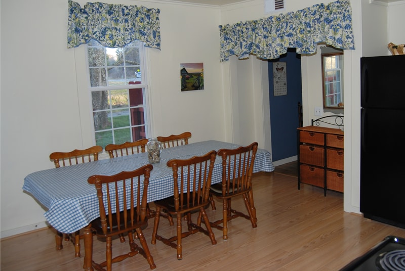 The fully equipped kitchen has new appliances and seating for eight.