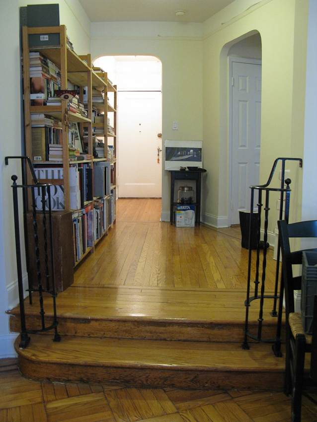 Foray + Library with two steps down leading into the living room.
