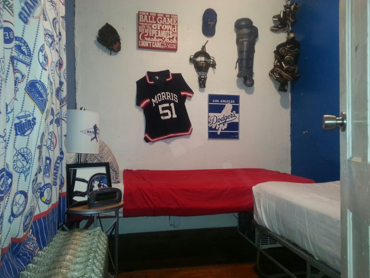 Baseball room outfitted with two twin beds. Ideal for parent and players first night--second bed can be removed after they are in camp. Also for two needing separate beds. A double can be used. Space at foot of bed for suitcase. Plenty of under bed storag