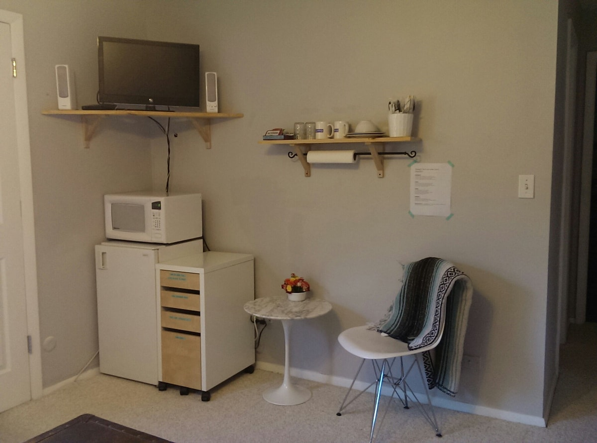 Mini-fridge, microwave, marble table and Eames-style chair in your room