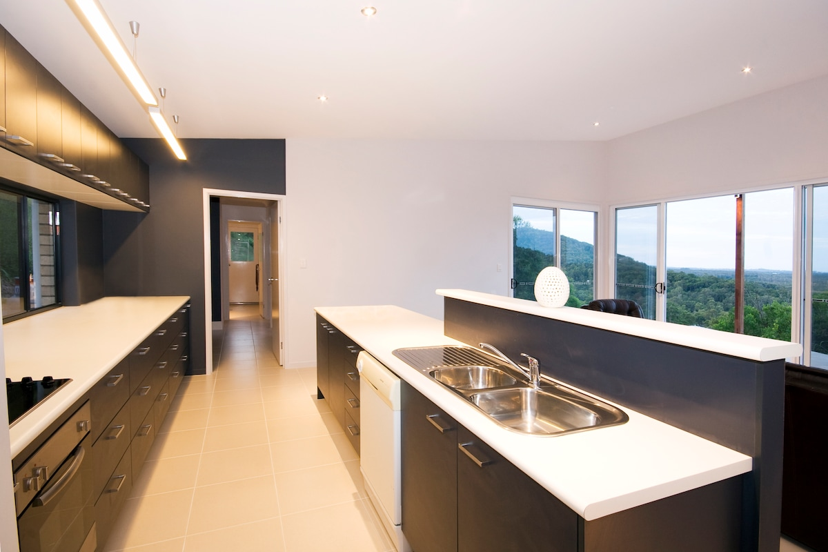 The open kitchen, living area looking through to the back door.