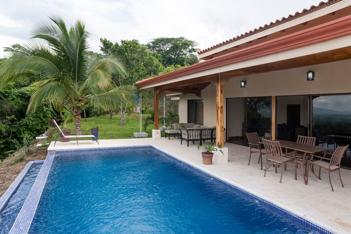 Relax in the Infinity pool or in the shade of the porch