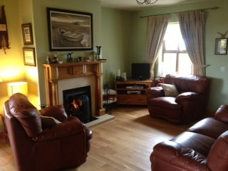 Relaxing livingroom with open turf/log fire.