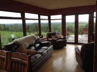 Bright and relaxing sunroom/diningroom with outstanding views of local countryside.