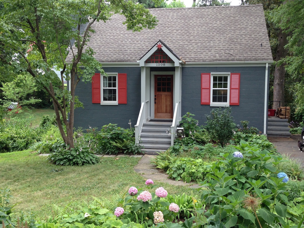 Cozy cape in a wooded, centrally located neighborhood.