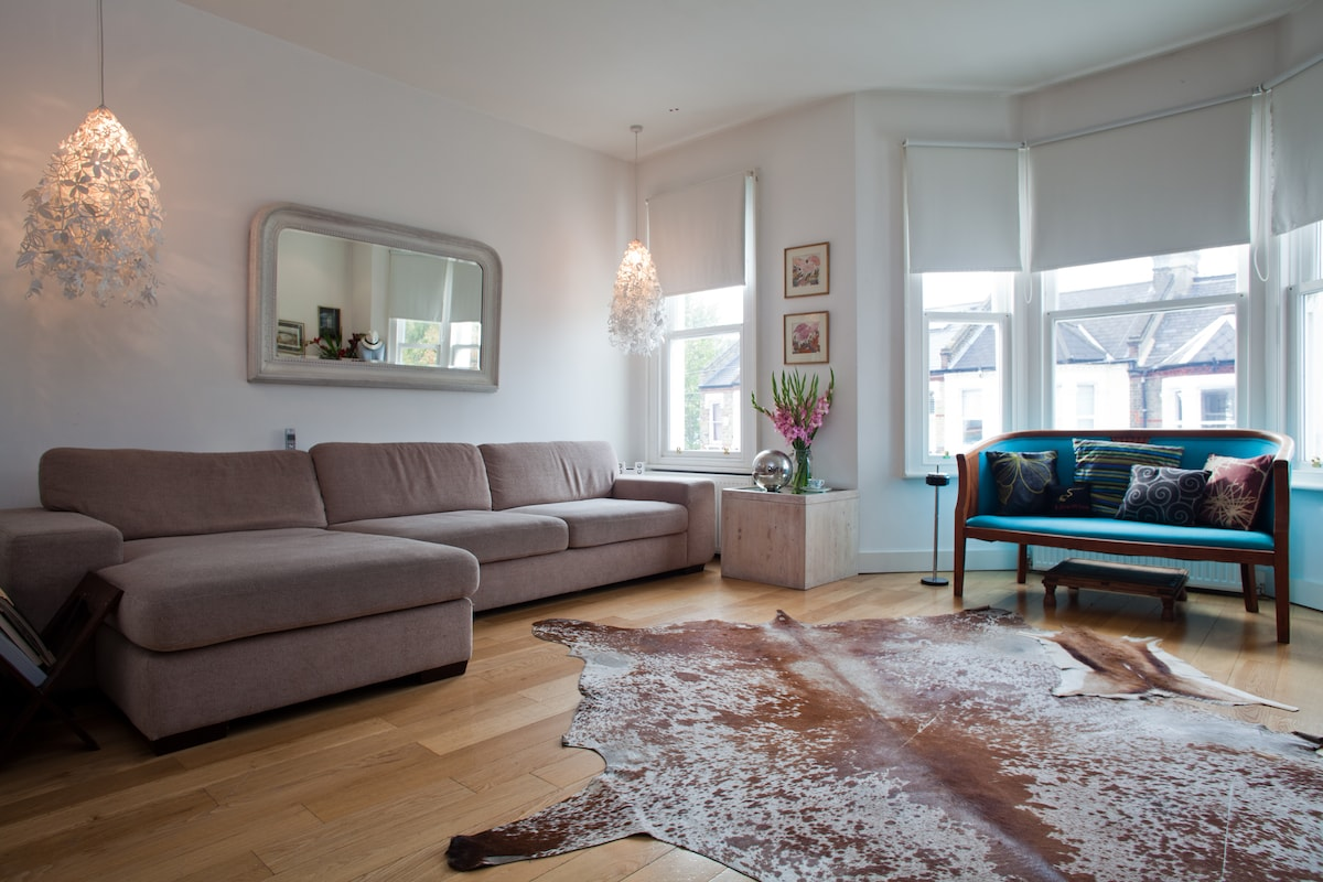 Living Room with style and comfort, relax after a day in town on our sofa and unwind 24sqm