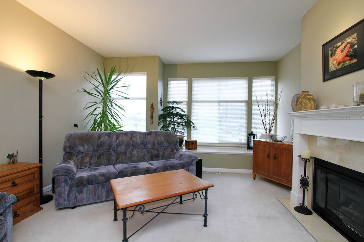 Shared living room faces West great for sunsets and on a clear day you can see Grouse Mountain.