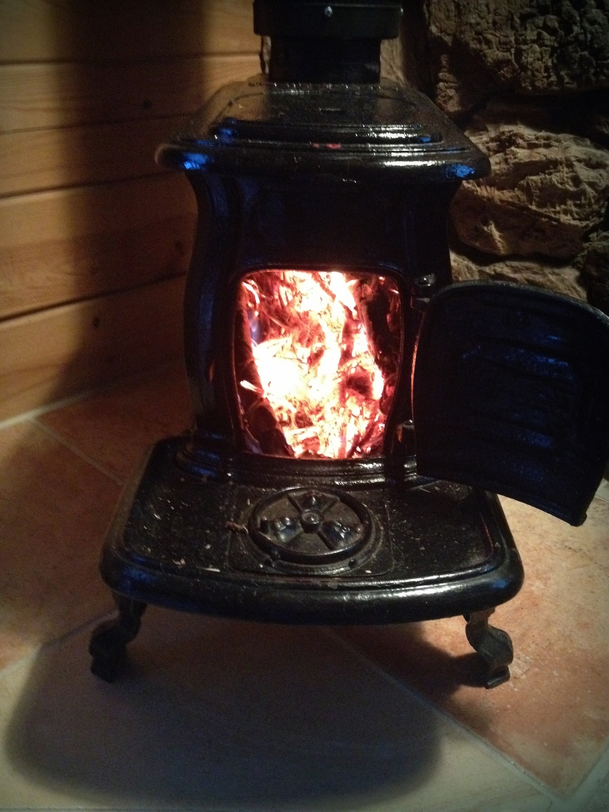 Old-fashioned wood stove for fires on chilly nights.