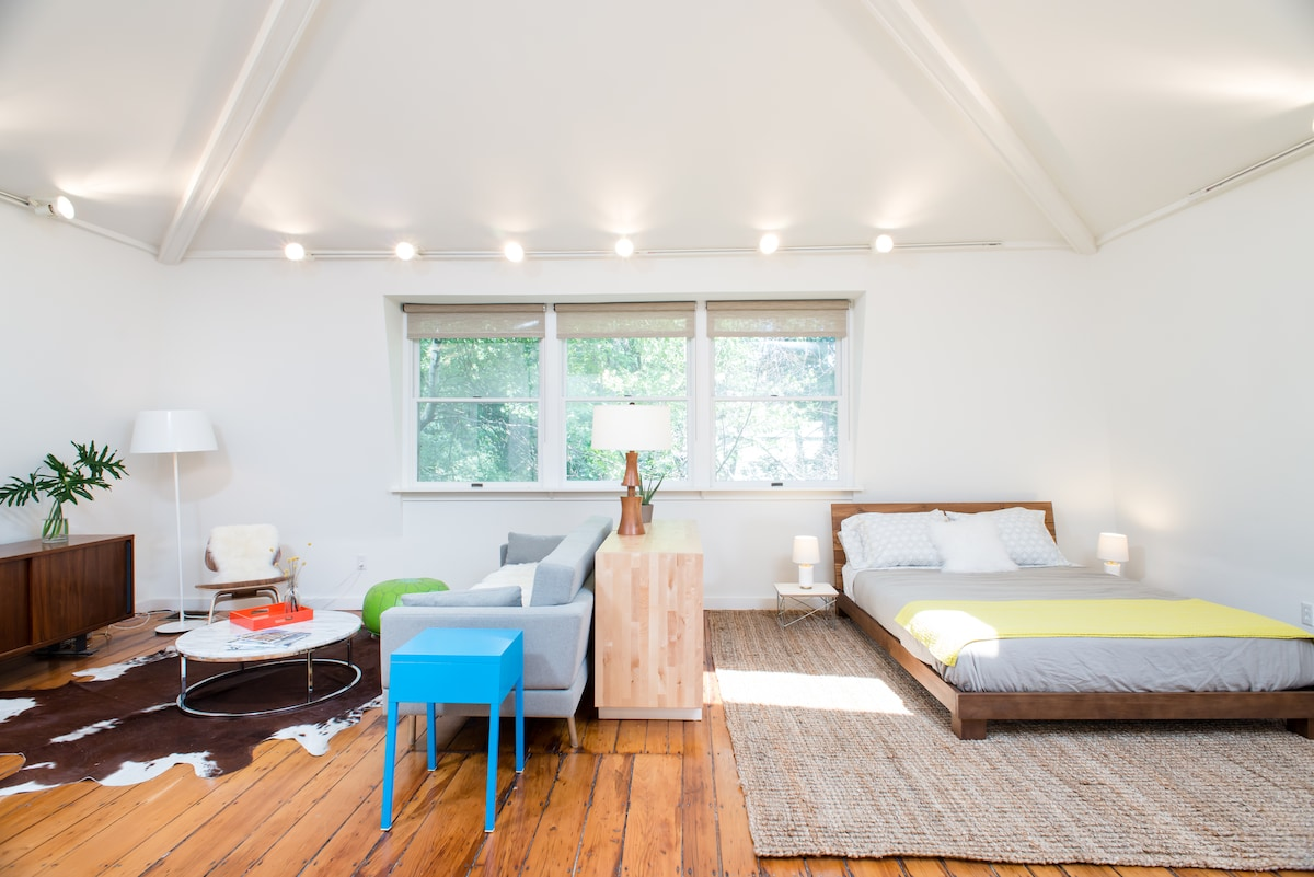 A view of the living space. A total of six windows, plus a skylight, give it a bright and spacious feel.
