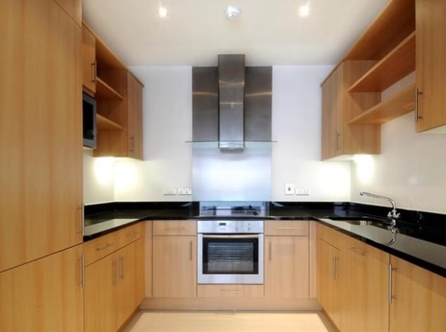 Fully equipped designer kitchen featuring professional coffee machine and steamer to name but a few