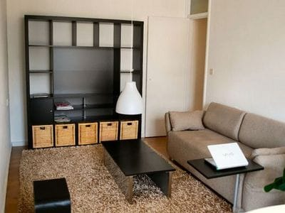 living room with sofa that turns into spare single bed