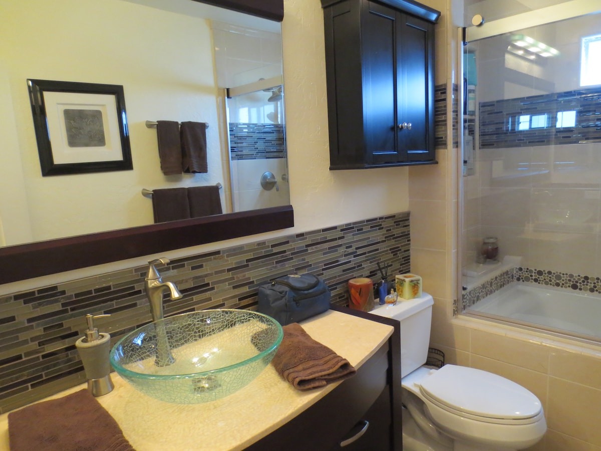 New tile bathroom with jacuzzi tub and ahower