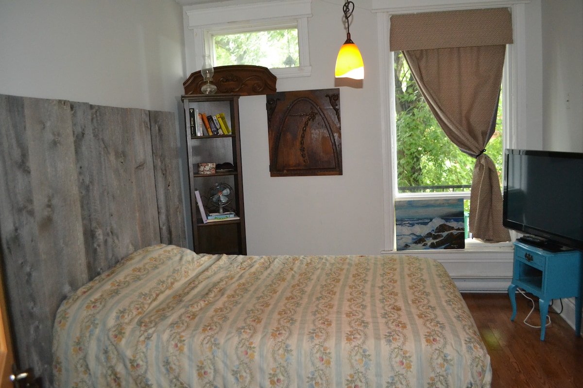 Bedroom 1 with flat screen and closets