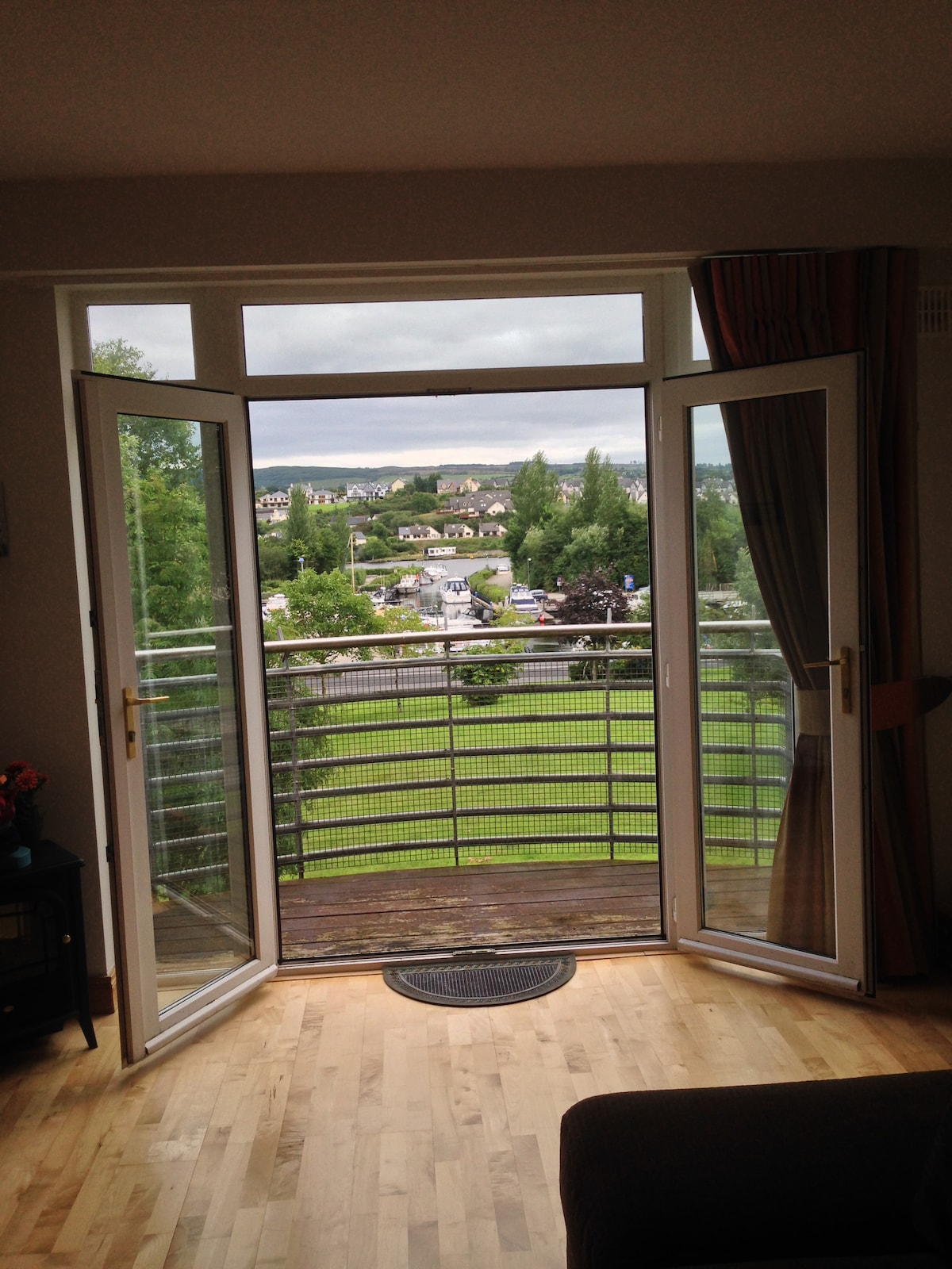 Large doors open onto balcony to view