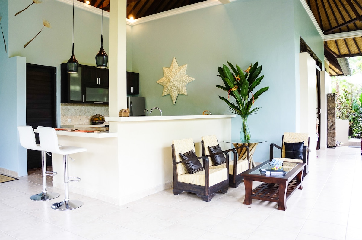 A kitchen bar and several conversation areas will have your family enjoying your holiday even more.