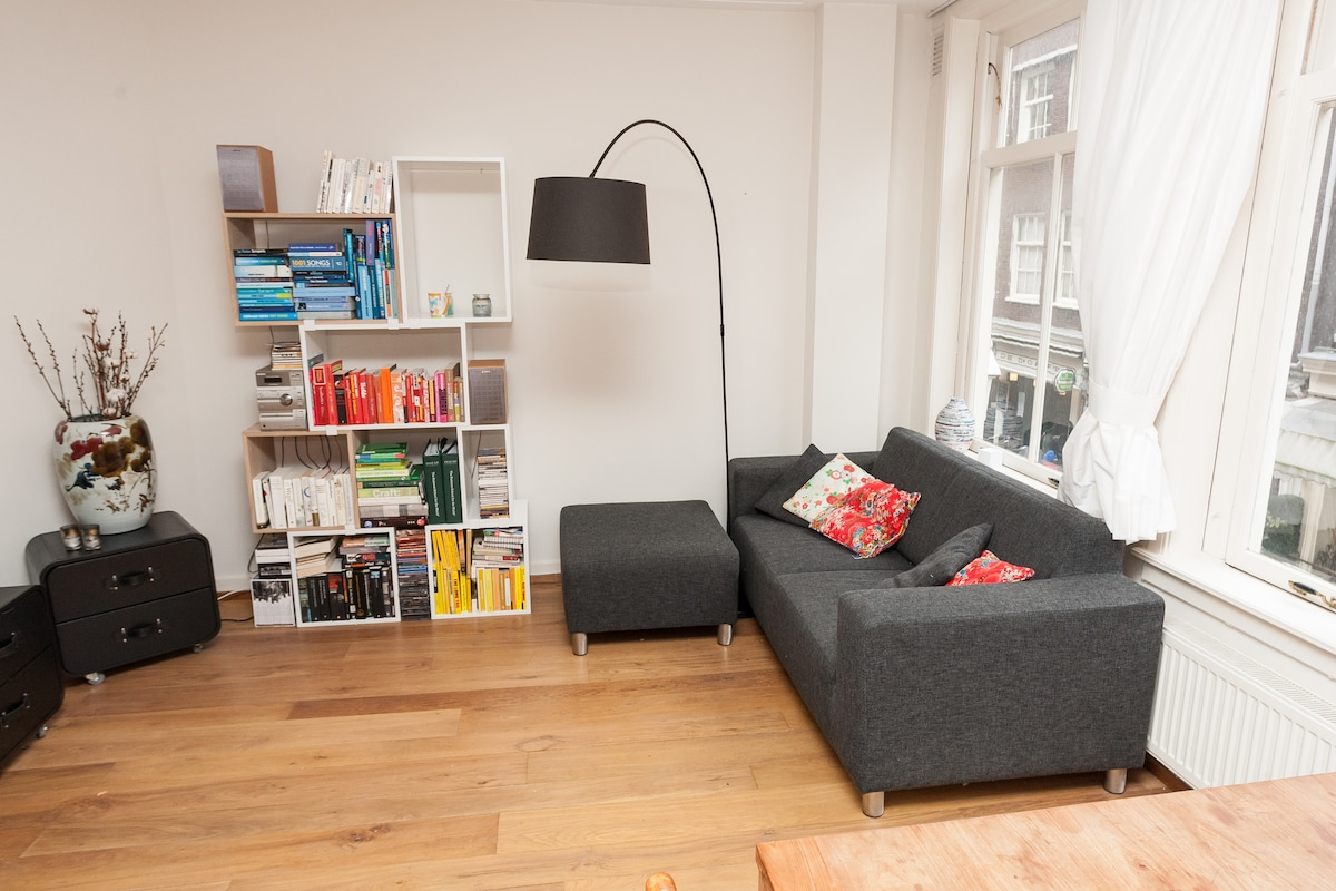 Comfy couch and TV - and take a look outside to see the people walking by!
