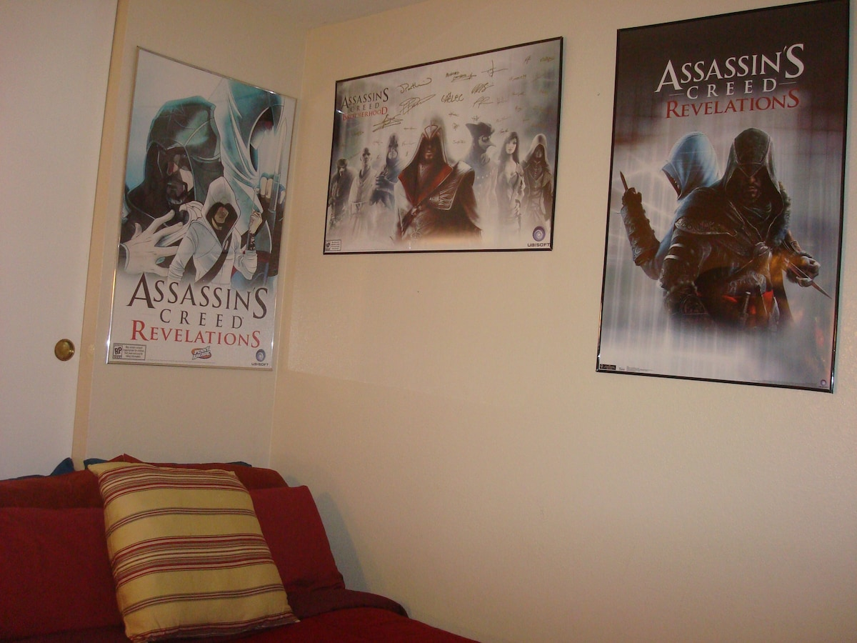 Assassin's Creed posters on the wall because this is my daughter's room and she is a gamer.