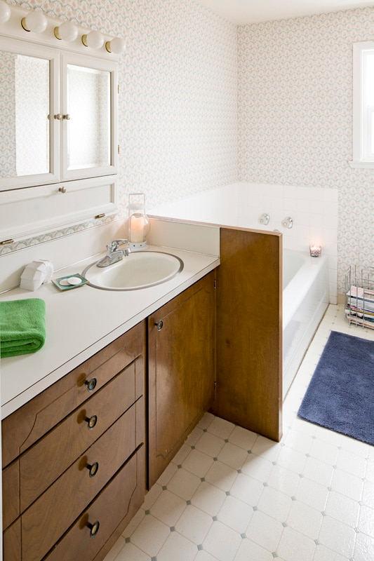 A seperate shower room frees up wait time in the spacious bathrom with tub