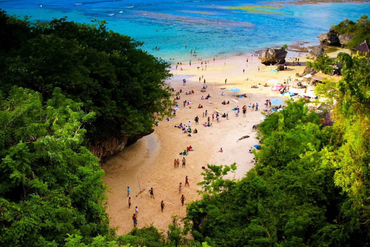 To get to this beach, you go through a rock-cave. Sometimes there's monkey that visit.
