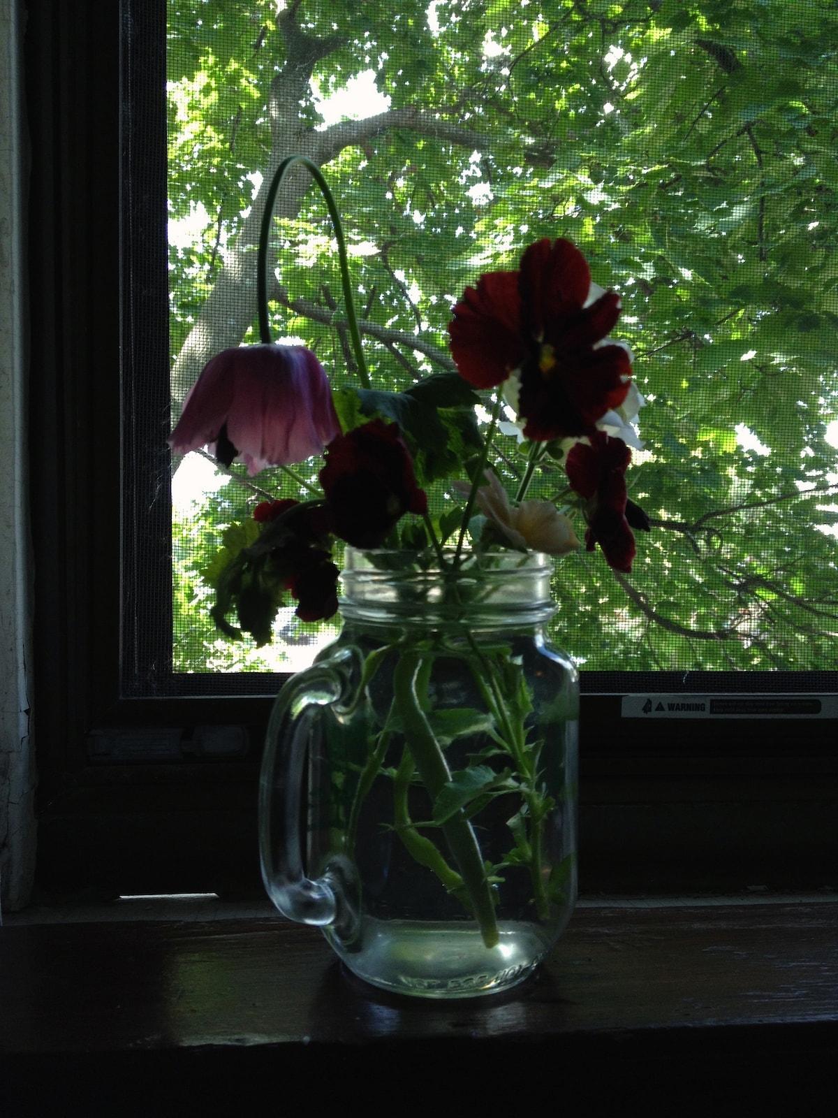 Room detail -summer garden flowers.