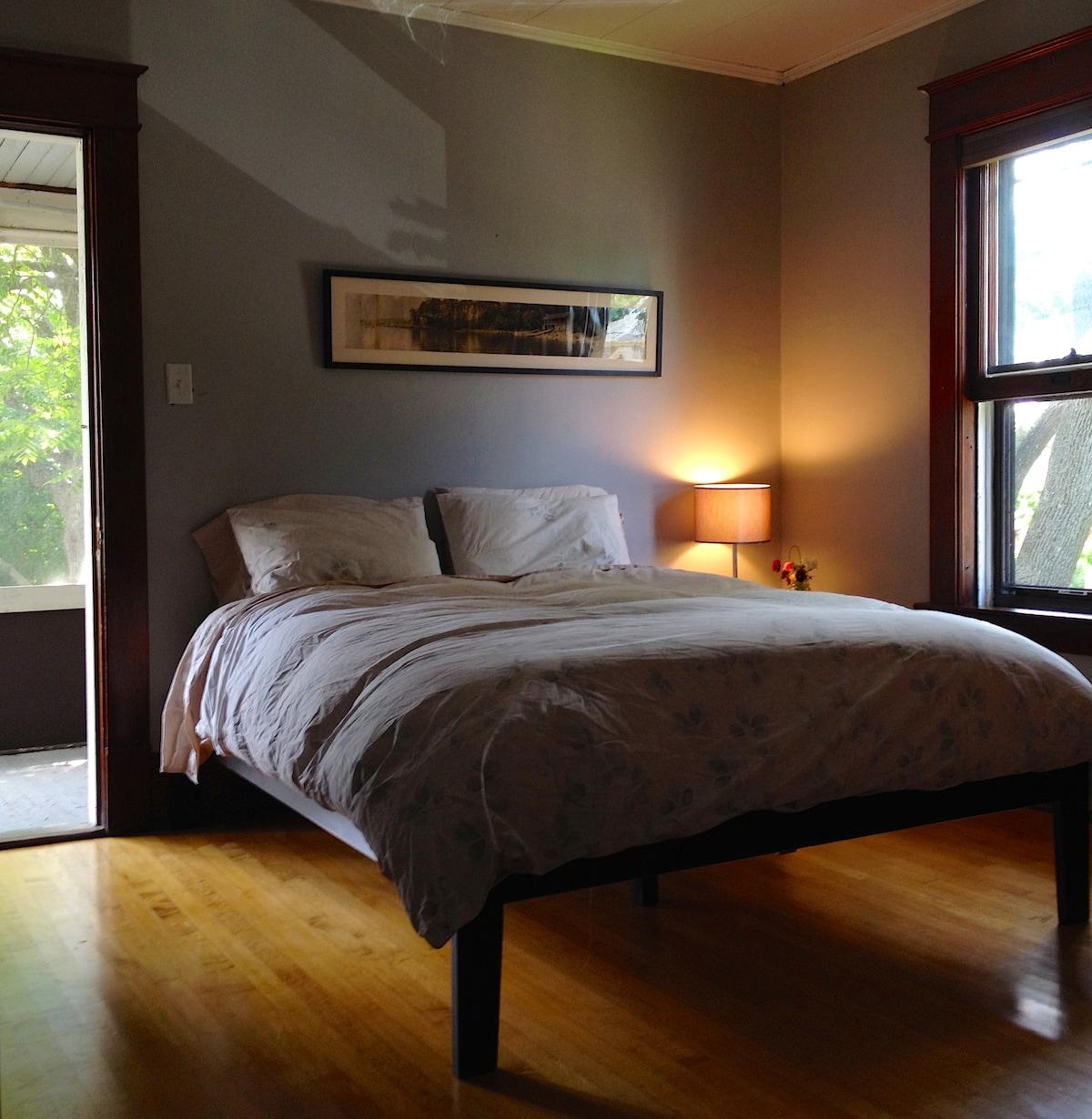Your second floor room with queen bed.