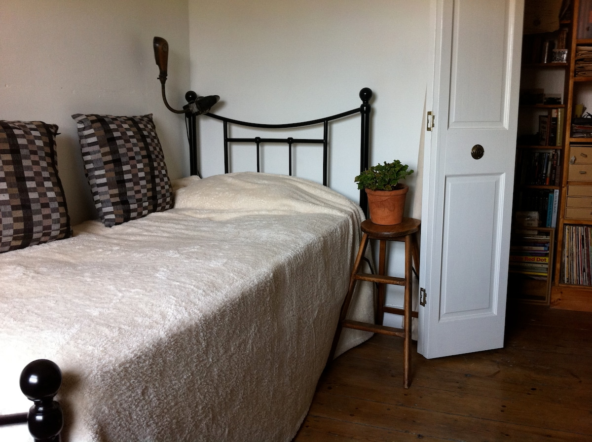 Single bedroom with new mattress and bed, and folding door to hall.