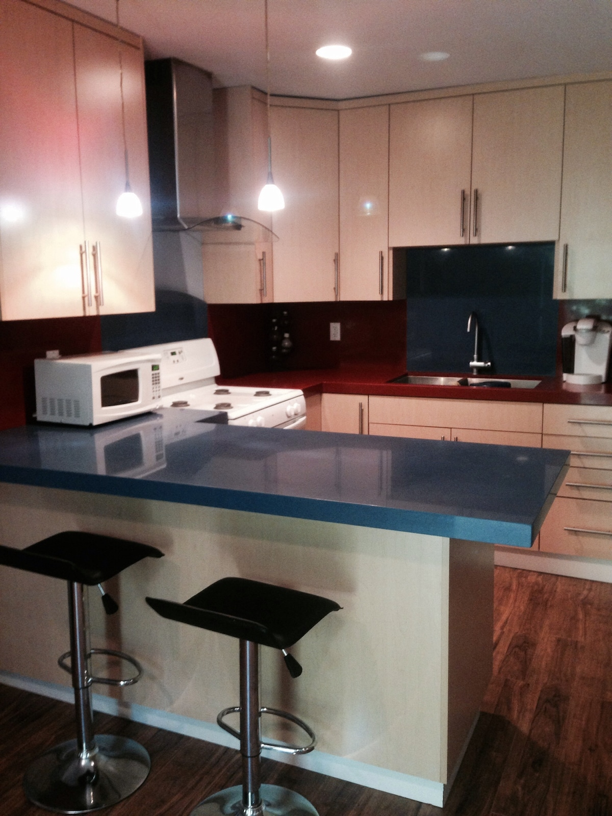 A fabulous kitchen, with everything you need for cooking and eating, a keurig coffee maker and full fridge with freezer.