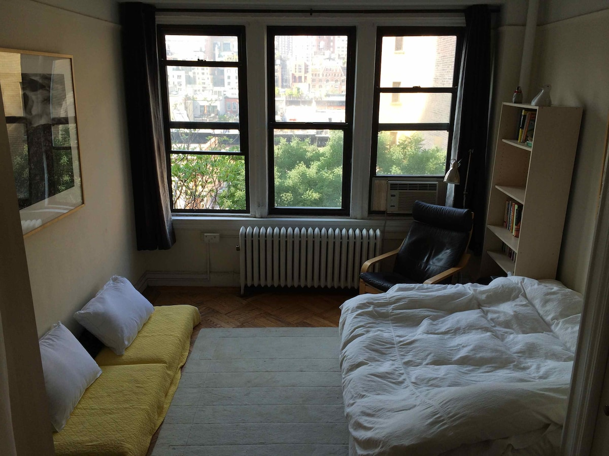 Bedroom is bright, quiet, south-facing, and cozy