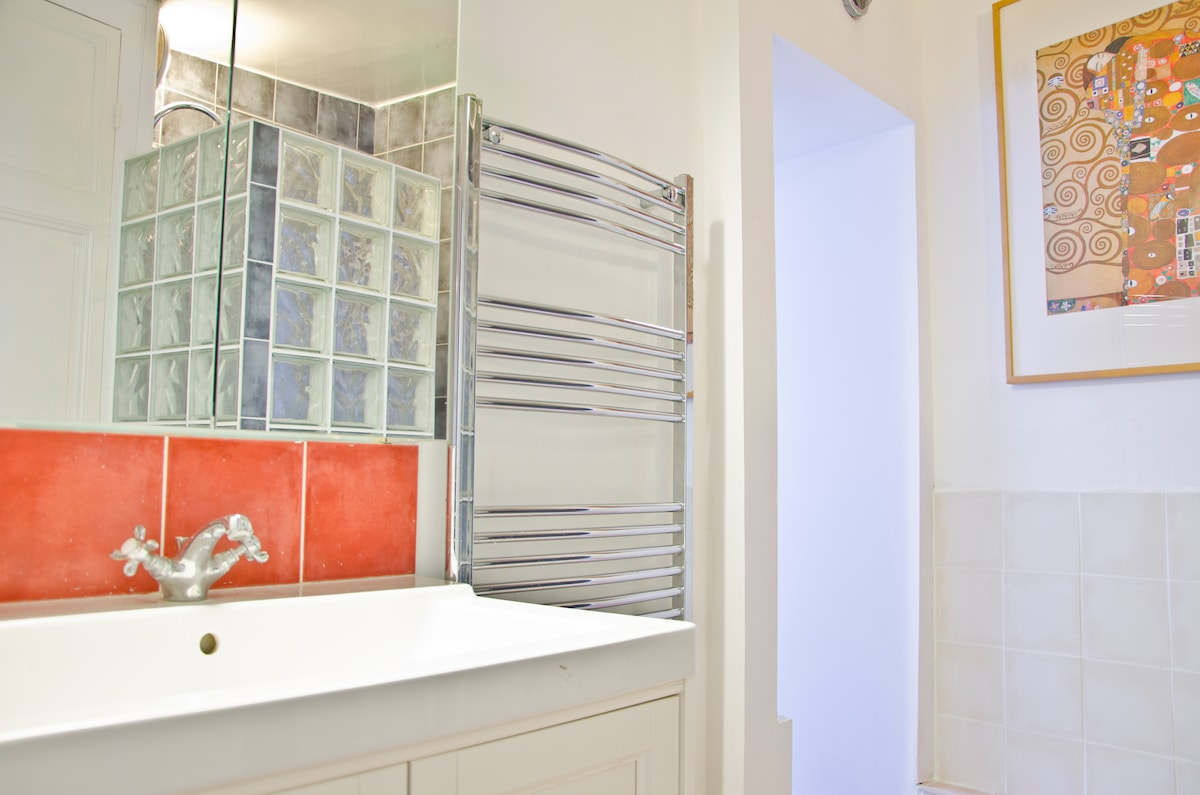 front en suite bathroom with large basin, heated towel rail, power shower.