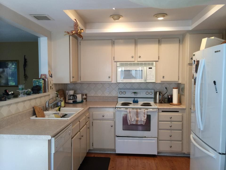 The kitchen features a 4-burner stove, standard sized oven, refrigerator, dish washer, garbage disposal, lots of cabinet space, electric kettle, coffee maker, toaster, and lots of pots, pans, and utensils.